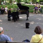 For the majority of New Yorkers not at the parade, life went on. Classical pianist Colin Huggins performs in Washington Square Park