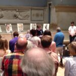 Judson Memorial Church prays. The displayed portraits are of hate-crime victims and LGBT homeless persons.